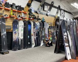 snowboards and boots at Helm of Snu Valley in San Jose and Capitola